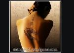 Tatuaj feminin cu dragon